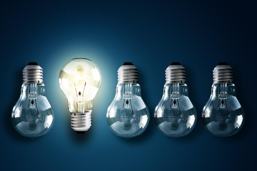 Dark and lit light bulbs