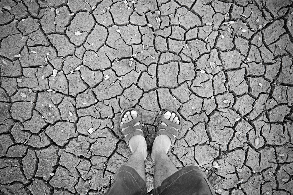 feet on cracked soil