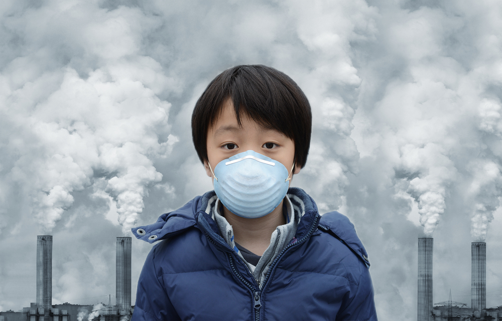 boy with smog mask